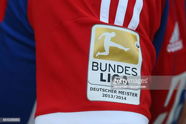 The DFL German Championship Winner logo for the season 2013/14 is dispatch on the FC Bayern Munich match jersey during the Bundesliga match between...