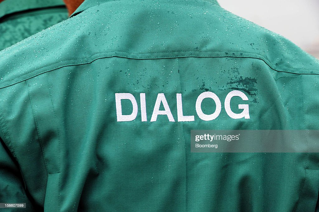 The Dialog Group Bhd. logo is displayed on a company jacket at a storage terminal site in Pengerang, Johor, Malaysia, on Tuesday, Dec. 18, 2012. Dialog, Malaysia's second-biggest oil and gas services provider, said it signed some customers for the 1.9 billion-ringgit ($620 million) storage terminal it's developing with Royal Vopak NV. Photographer: Munshi Ahmed/Bloomberg via Getty Images