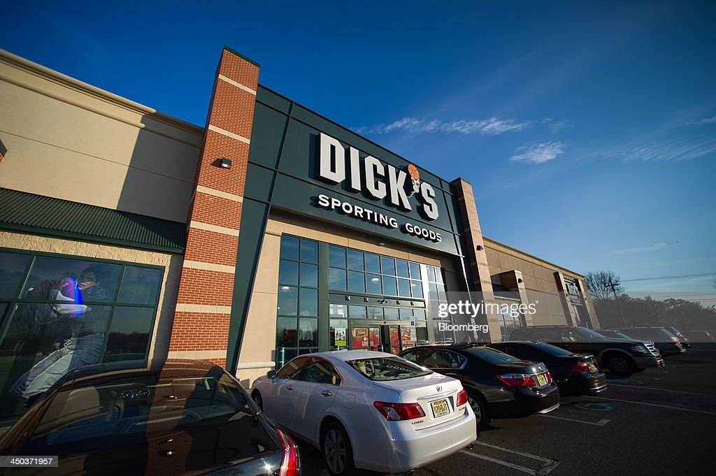 The Dick's Sporting Goods logo is displayed on the exterior of a retail location in Paramus, U.S., on Saturday, Nov. 16, 2013. Dick's Sporting Goods may report 3Q EPS slightly ahead of forecast, ests., according to Janney, Raymond James analysts, when it reports 3Q results 7:30am Nov. 19. Photographer: Ron Antonelli/Bloomberg via Getty Images