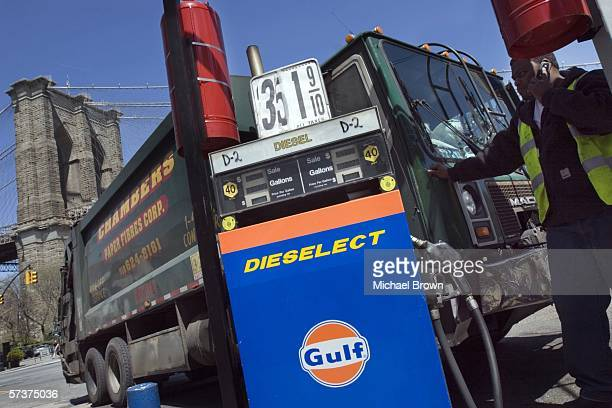 The diesel fuel price is displayed at a Gulf filling station as the Brooklyn Bridge rises in the background on Old Fulton Street April 20 2006 in the...