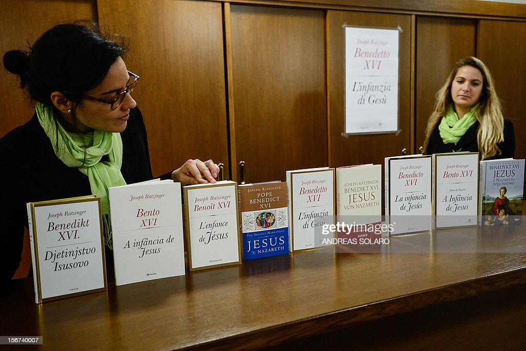 "The different editions of Pope Benedict XVI's new book ""Childhood of Jesus"" are displayed during the presentation of the book to the press on November 20, 2012 at the Vatican. ""Childhood of Jesus"" is the third volume of Joseph Ratzinger's 'Jesus of Nazareth' series. AFP PHOTO / ANDREAS SOLARO"