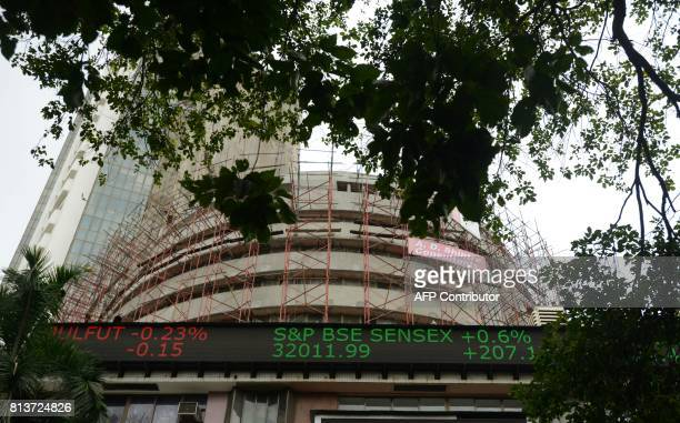 The digital broadcast on the facade of the Bombay Stock Exchange displays the benchmark share index SENSEX crossing 32000 points in the city of...