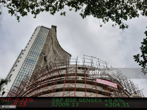 The digital broadcast on the facade of the Bombay Stock Exchange displays the benchmark share index SENSEX crossing 32000 points on July 13 2017 in...