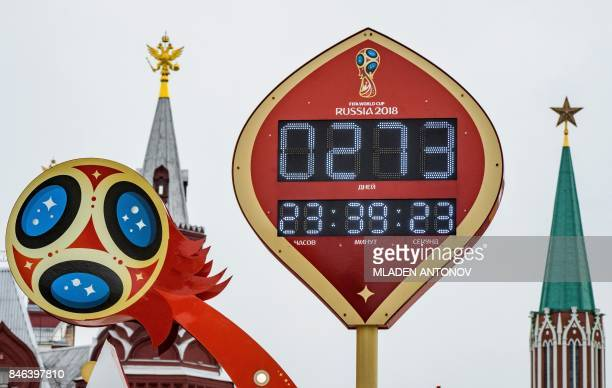 The digital FIFA World Cup 2018 countdown clock placed in front of the Red Square and the Kremlin in Moscow is pictured on September 13 2017 FIFA...