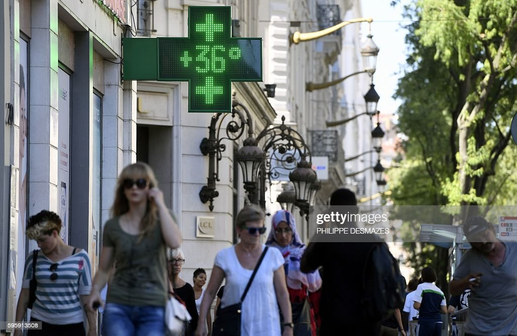 The digital sign of a pharmacy reads 36 degrees Celsius on August 26 2016 in Lyon central eastern France as a wave of heat strikes France / AFP /...