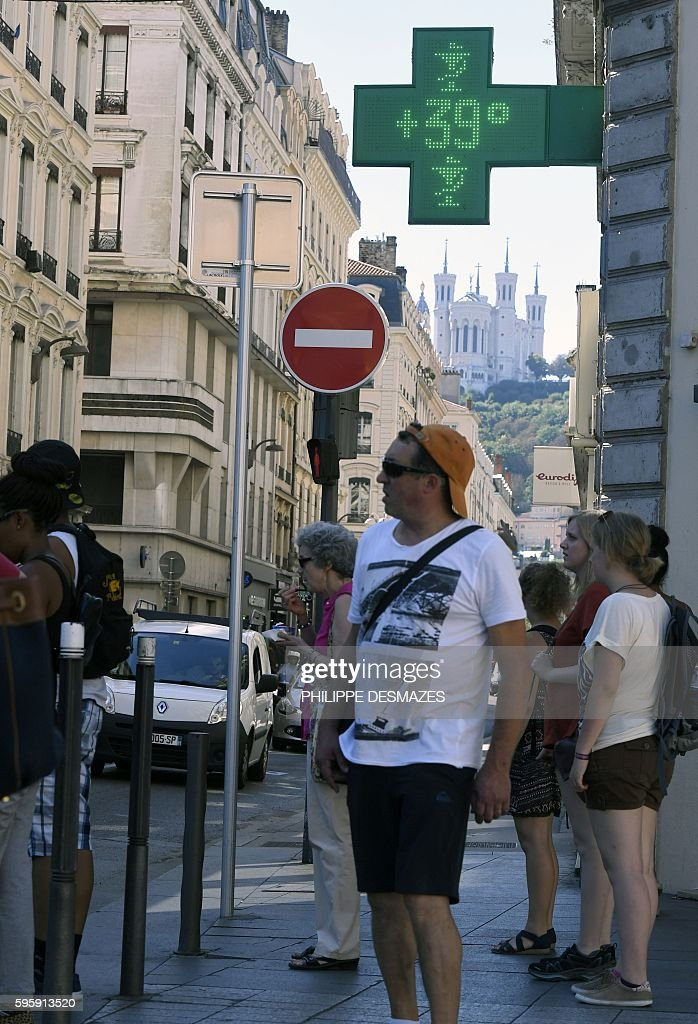 The digital sign of a pharmacy reads 39 degrees Celsius on August 26 2016 in Lyon central eastern France as a wave of heat strikes France / AFP /...