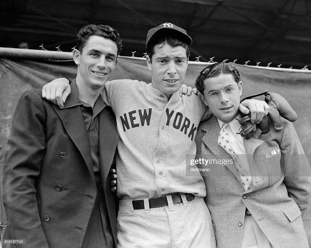 The DiMaggio brothers, Vince, of the Cincinnati Reds; Joe, of the New York Yankees, and Dominic, of the Boston Red Sox, (from left to right) shown together at the All-Star baseball game at Tampa, Florida, for benefit of the Finnish Relief Fund. Joe played centerfield and scored the lone run for the American League team, which lost 2-1. An ankle injury kept Dominic on the sidelines.
