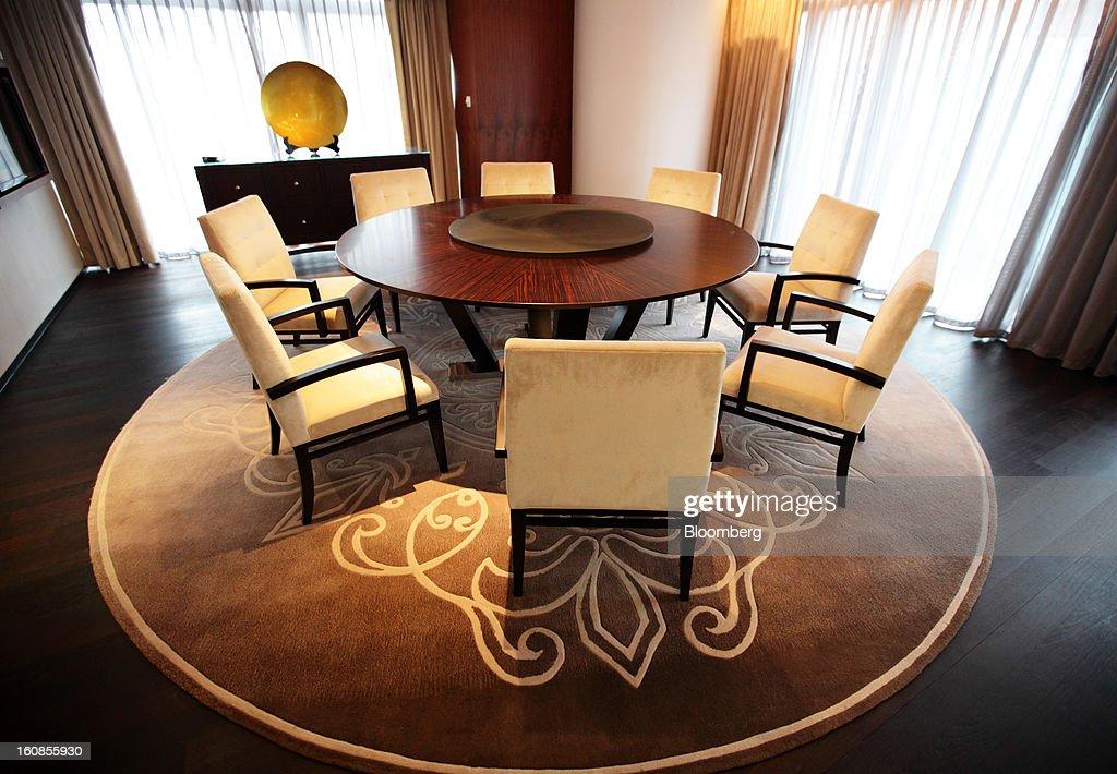 The dining area of the chairman's suite at the Langham Xintiandi hotel, developed by Shui On Land Ltd., is seen in Shanghai, China, on Wednesday, Feb. 6, 2013. China's economic growth accelerated for the first time in two years as government efforts to revive demand drove a rebound in industrial output, retail sales and the housing market. Photographer: Tomohiro Ohsumi/Bloomberg via Getty Images