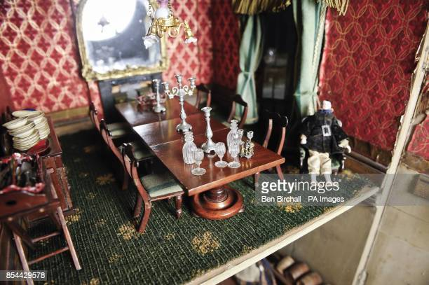 The dining room in a Victorian doll's house which is to be auctioned at Chorley's in Gloucestershire on 28 November 2013