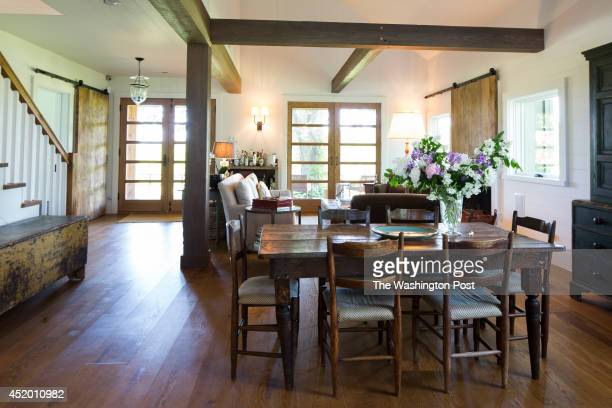 The dining room includes rustic chairs and a farm table Fragrant wild flowers in a crystal vase were hand cut from the property Real estate developer...