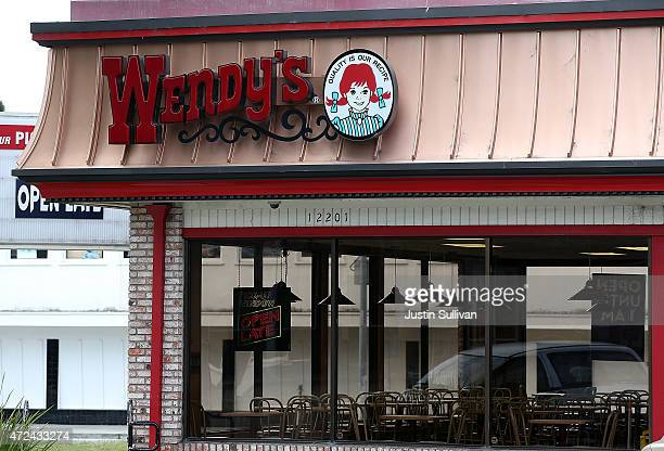 The dining room sits empty at a Wendy's restaurant on May 7 2015 in Richmond California Wendy's announced plans to sell 640 of its company owned...