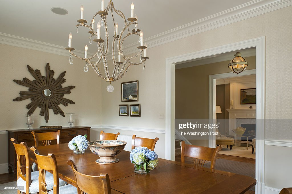 The dining room sports new wallpaper and furniture from Tracey Patch's family July 22 2014 in Chevy Chase MD Ted Patch along with his wife Tracey...