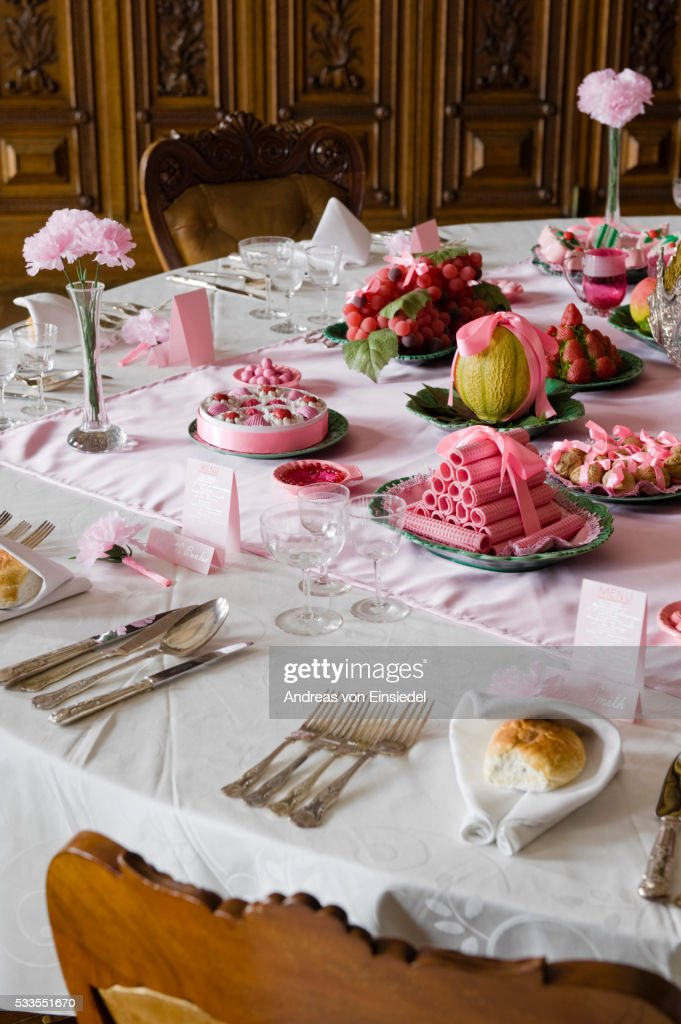 The Dining Room Table With Place Settings, Desserts And Fruits At Kingston  Lacy, Dorset