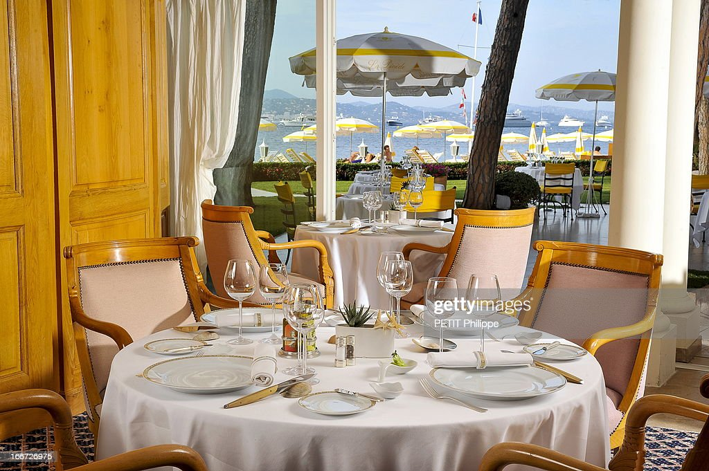 The dinning room of the restaurant La Vague D'Or in the hotel Residence de la Pinede on March 21, 2013 in Saint Tropez,France. Chef Arnaud Donckele of the restaurant La Vague D'Or in the hotel La Residence de la Pinede who received his 3rd star from the famous gourmet guide Michelin.