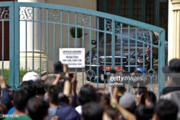 The diplomatic car transporting North Korean ambassador to Malaysia Kang Chol is seen driving up to the departure hall of the Kuala Lumpur...