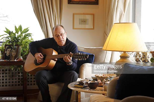 'The director and actor Carlo Verdone playing guitar at home for a photo shooting Rome Italy 22nd January 2014 '
