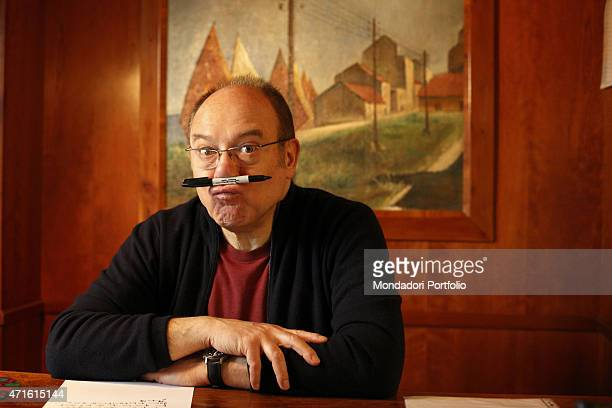 'The director and actor Carlo Verdone posing for a photo shooting in his study at home Rome Italy 22nd January 2014 '