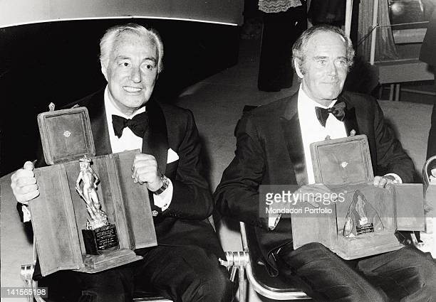 The director and actor Vittorio De Sica and the US actor Henry Fonda are photographed together in the ancient theatre of Taormina for the 18th...
