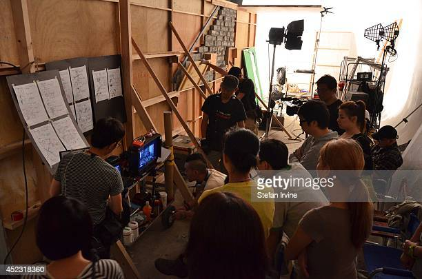 The director and crew reviewing a take on the Hong Kong film set of Rigor Mortis a horror film about vampires The film is Juno Mak's directorial...