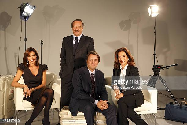 The director Clemente Mimun and the journalists Giuseppe De Filippi Cesara Buonamici and Cristina Parodi posing for a photo shooting in the TG5...