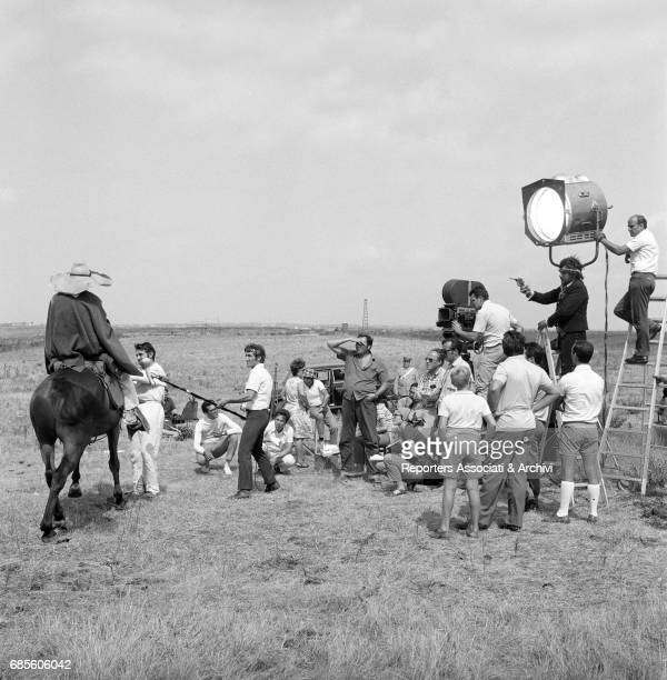 The director Giulio Petroni shooting a scene on the set of the film 'Tepepa' with his crew Among the actors Tomas Milian holding a gun Italy 1968