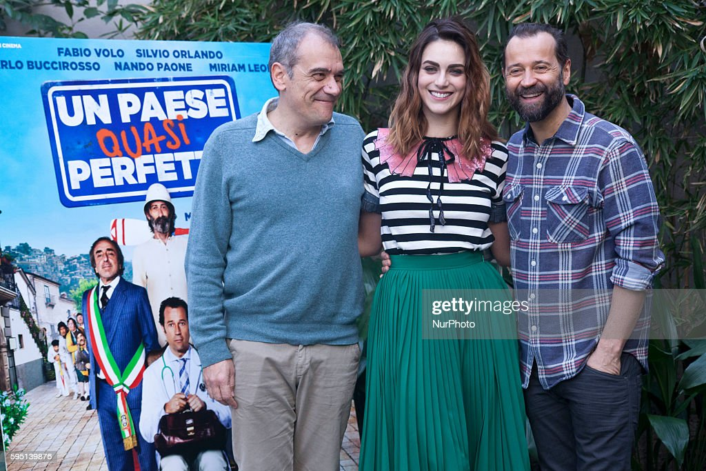 The director Massimo Gaudioso Miriam Leone and Fabio Volo poses for photographers during 'Un paese quasi perfetto' photocall on March 21th 2016 in...