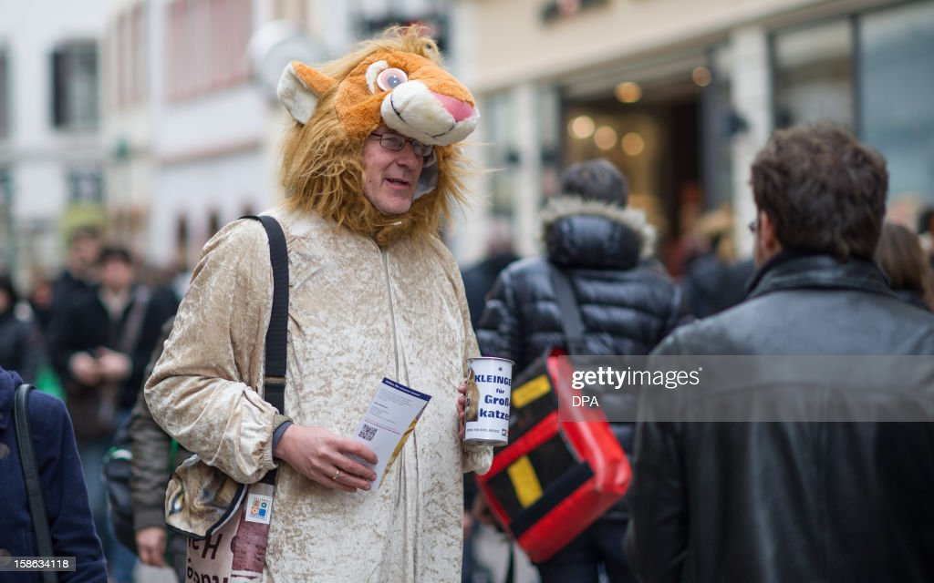 The director of a zoo in Heidelberg, Klaus Wuennemann wears a lion costume and asks for donations for his zoo, in Heidelberg, southern Germany. The director collects money for a new enclosure for lions.