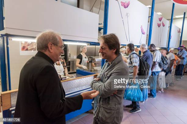 The director of Caritas Rome Msgr Enrico Feroci and the Deputy Mayor Luca Bergamo visits the Caritas canteen of Colle Oppio on the midAugust holiday...