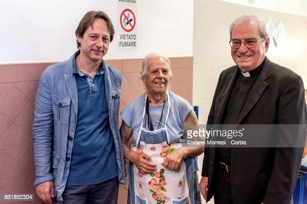 The director of Caritas Rome Msgr Enrico Feroci and the Deputy Mayor Luca Bergamo with a volunteer during visits the Caritas canteen of Colle Oppio...