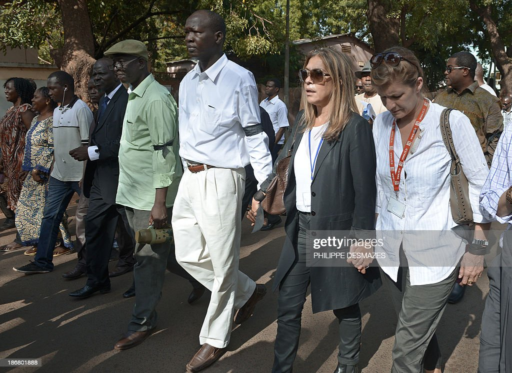 The director of France Medias Monde, Marie-Christine Saragosse (2ndR), and the director of Radio France Internationale (RFI) Cecile Megie (R), attend a white march with Malian journalists on November 4, 2013 in Bamako, in memory of Radio France Internationale (RFI) journalist Ghislaine Dupont and sound technician Claude Verlon killed in the town of Kidal. French troops were working today with Malian security forces to hunt the killers of the two French journalists shot dead in the west African nation's rebel-infested northern desert. Ghislaine Dupont, 57, and Claude Verlon, 55, were kidnapped and killed by what French Foreign Minister Laurent Fabius said were 'terrorist groups' in the flashpoint northeastern town of Kidal on November 2, 2013.