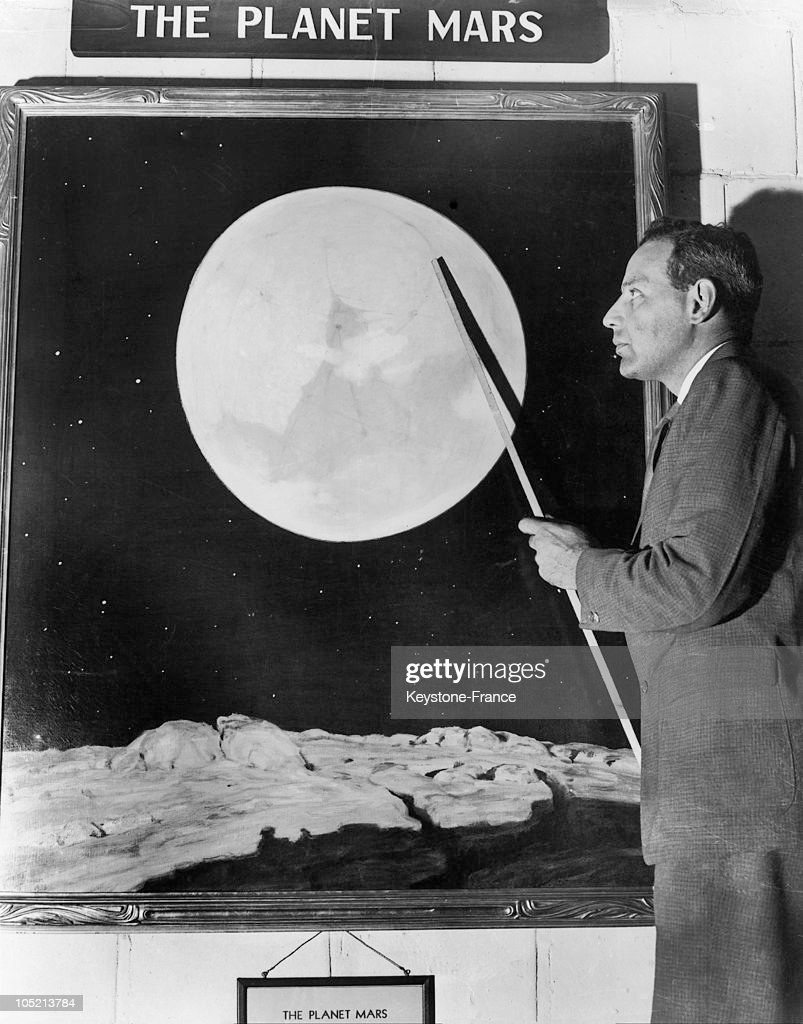 The Director Of Philadelphia'S Planetarium Pointing Out One Of The Canals On The Planet Mars In 1945.