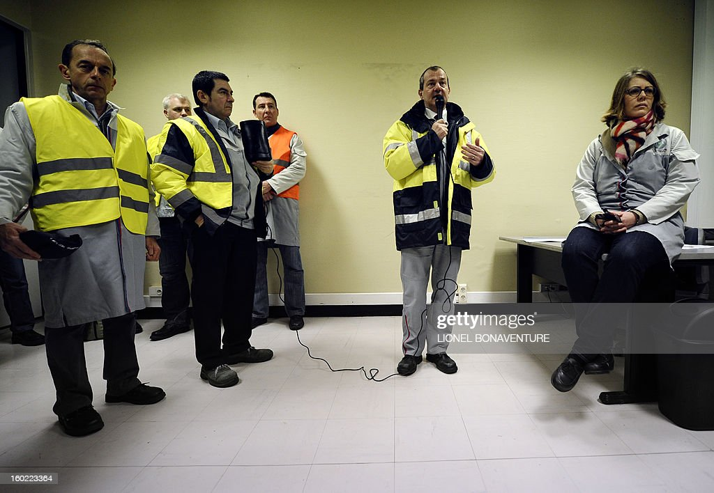 The director of PSA Peugeot Citroen carmaker plant of Aulnay-sous-Bois Laurent Vergely briefs supervisors before on strike workers occupy the factory to protest against plans to sell the plant and lay off thousands of employees, on January 28, 2013 in Aulnay-sous-Bois, a Paris' suburb.