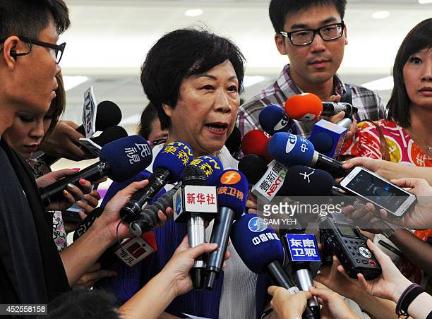 The Director of Taiwan's Civil Aeronautics Administration Sheng Ching speaks to media at the Sungshan airport in Taipei on July 23 2014 More than 40...