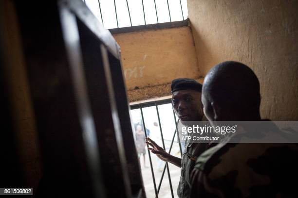 The director of the Bouar detention centre asks a guard to open a door at the prison in Bouar western Central African Republic on October 13 2017 In...