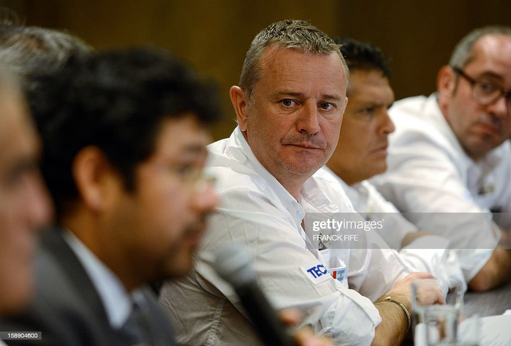 The Director of the Dakar Rally, Etienne Lavigne, listens during a press conference on the Dakar measures related to the environment and the protection of archaeological and palaeontological areas in Peru, on January 3, 2013 in Lima. Palaeontologists have warned that the Dakar Rally, which will thunder through Peru, Argentina and Chile next month, poses a serious risk to whale and dolphin fossils dating back more than 20 million years. AFP PHOTO / FRANCK FIFE
