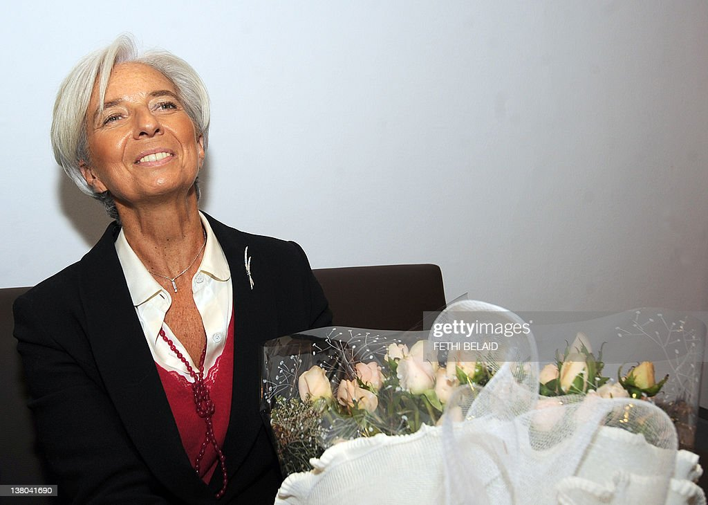 The Director of the International Monetary Fund (IMF) France's Christine Lagarde poses in front of a bunch of flowers upon her arrival on February 1, 2012 in Tunis. Christine Lagarde pays a two-day visit to Tunisia and is expected to the governor of the Tunisian central bank and Tunisian leaders.