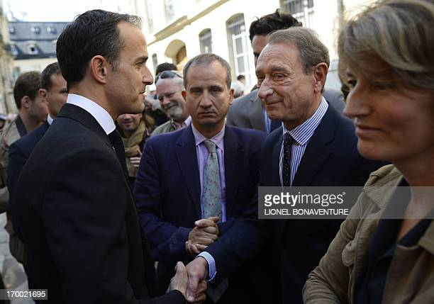 The director of the Paris Institute of Political Studies Frederic Mion shakes hands on June 6 2013 with the Mayor of Paris Bertrand Delanoe during a...