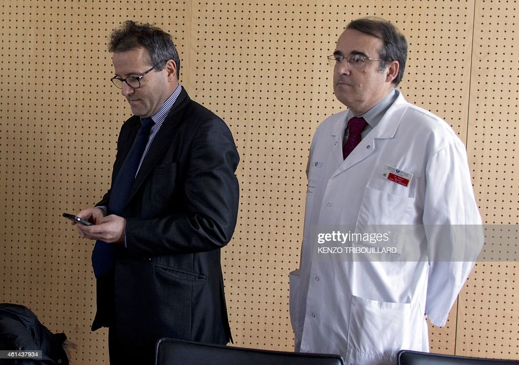 The director of the state-run Paris hospitals (AP-HP), <a gi-track='captionPersonalityLinkClicked' href=/galleries/search?phrase=Martin+Hirsch&family=editorial&specificpeople=2273261 ng-click='$event.stopPropagation()'>Martin Hirsch</a> (L), arrives for a press conference with the head the emergency services at the Pitie-Salpetriere hospital, Doctor Bruno Riou, on January 12, 2015 at the hospital in Paris. The man who allegedly radicalized the Kouachi brothers involved in the Paris terror attacks, Farid Benyettou, 32, the former 'emir' of the Buttes Chaumont cell, was a nursing intern at the accident and emergency unit of the hospital since December. Hirsch said that Benyettou's internship at the hospital had been suspended.
