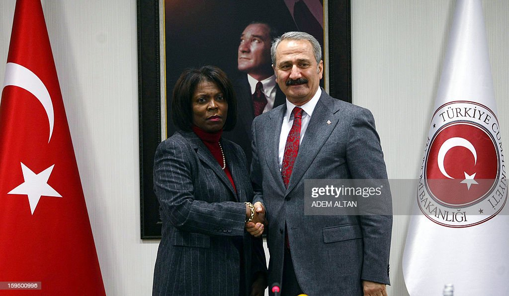 The director of the United Nations World Food Programme (WFP), Ertharin Cousin (L) poses with Turkish Economy Minister Zafer Caglayan after a press conference in Ankara on January 14, 2013.