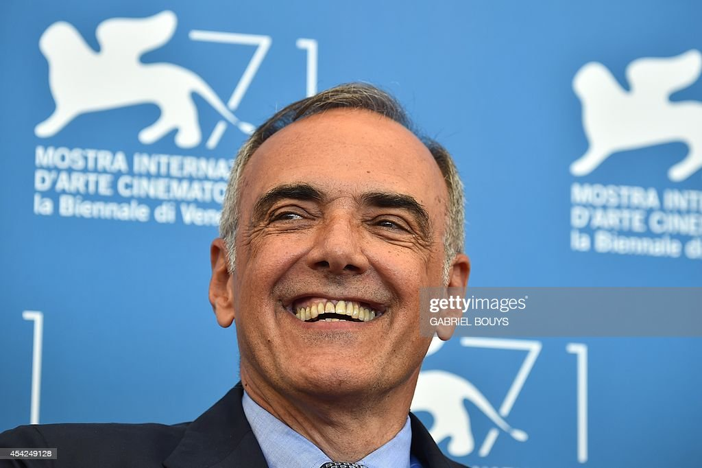 The director of the Venice Film Festival Alberto Barbera poses during a photocall on the opening day of the 71st Venice Film Festival on August 27, 2014 at Venice Lido.
