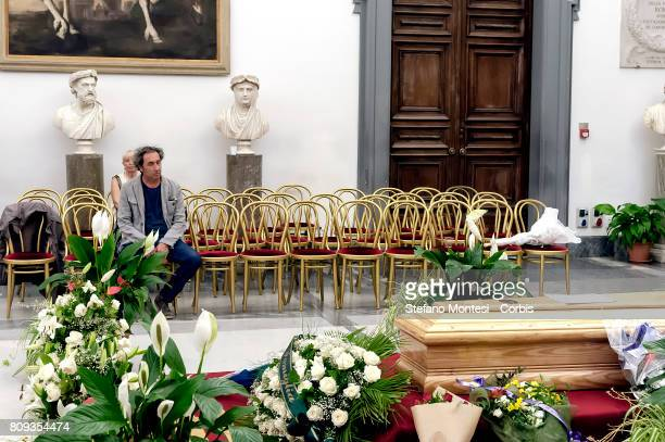 The director Paolo Sorrentino in front the coffin of Italian actor Paolo Villaggio lying in repose at Rome's city hall on July 5 2017 in Rome Italy...