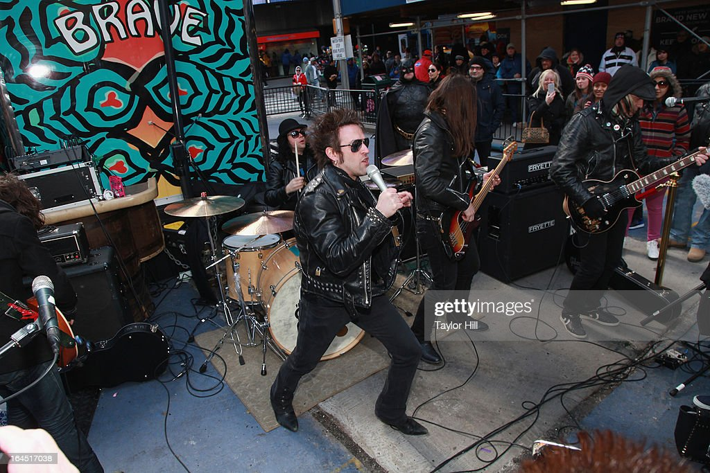 The Dirty Pearls perform during Lady Gaga's Born Brave Bus tour in Times Square on March 23, 2013 in New York City.