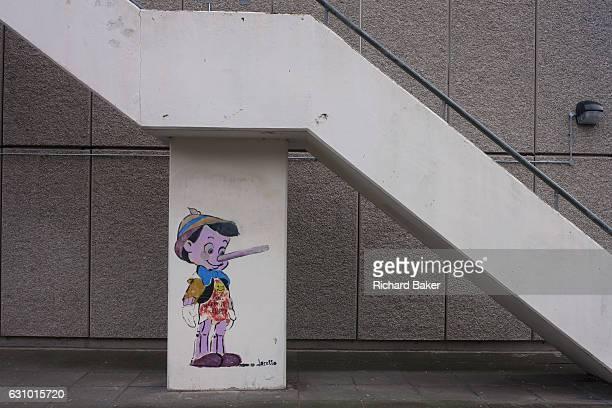The Disney cartoon character Pinoccio seen beneath concrete stairs on the Aylesbury Estate on 4th January London borough of Southwark England