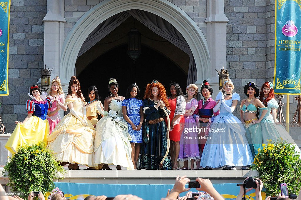The Disney Princess royal court with <a gi-track='captionPersonalityLinkClicked' href=/galleries/search?phrase=Gabby+Douglas&family=editorial&specificpeople=8465211 ng-click='$event.stopPropagation()'>Gabby Douglas</a> and her mom Natalie Hawkins pose during a royal celebration at the Magic Kingdom at Walt Disney World Resort in conjunction with Mother's Day festivities on May 11, 2013 in Lake Buena Vista, Florida.