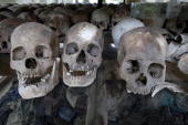 The display at the Choeung Ek Genocidal Center where 8000 human skulls sit in a glass case July 26 2010 in Phnom Penh province Today the UN backed...