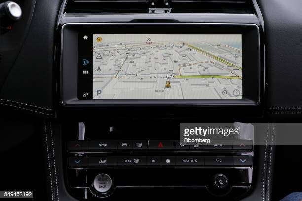 The display screen of a connected YandexAuto incar service system showing the company's real time maps and traffic navigator sits on the dashboard of...