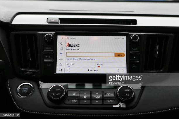The display screen of an integrated YandexAuto incar connected service system sits on the dashboard of a Toyota Motor Corp Rav4 automobile during a...