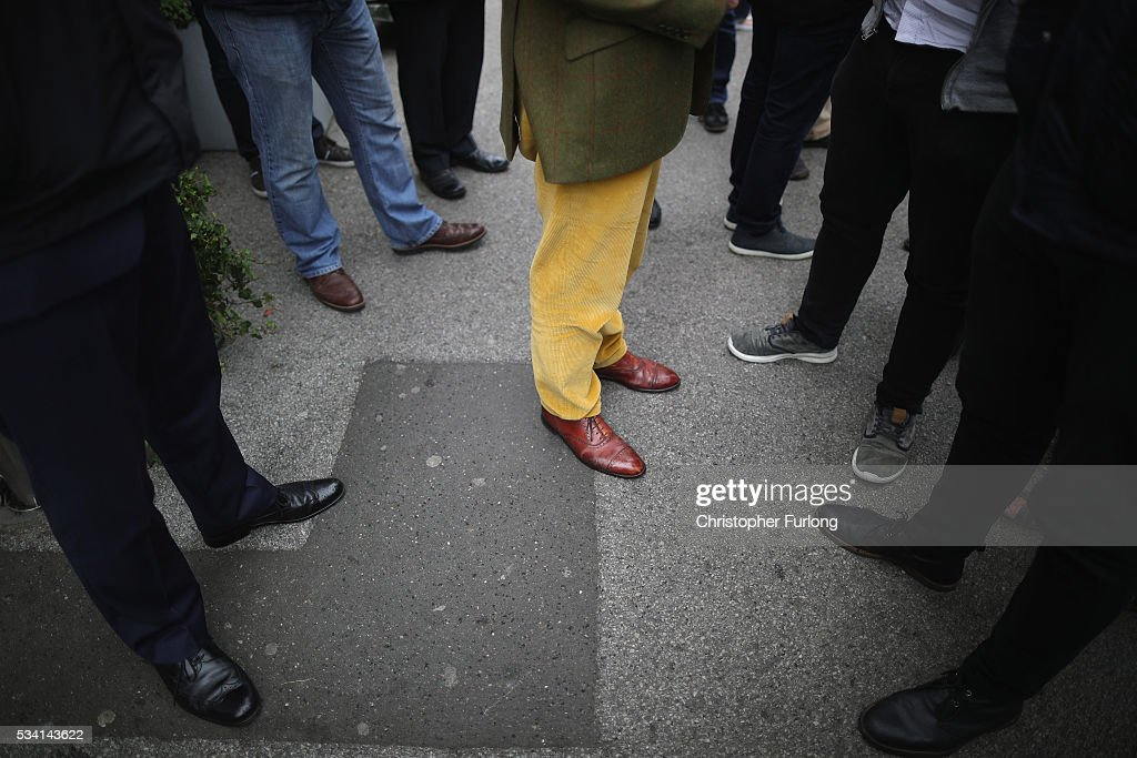 The distinctive attire of UKIP Leader <a gi-track='captionPersonalityLinkClicked' href=/galleries/search?phrase=Nigel+Farage&family=editorial&specificpeople=697991 ng-click='$event.stopPropagation()'>Nigel Farage</a>, contrasts with members of the media and public, as he campaigns for votes to leave the European Union on May 25, 2016 near Sheffield, England. <a gi-track='captionPersonalityLinkClicked' href=/galleries/search?phrase=Nigel+Farage&family=editorial&specificpeople=697991 ng-click='$event.stopPropagation()'>Nigel Farage</a> took his battle bus to Chapeltown, near Sheffield, encouraging British people to vote to leave the EU in the June 23rd referendum.