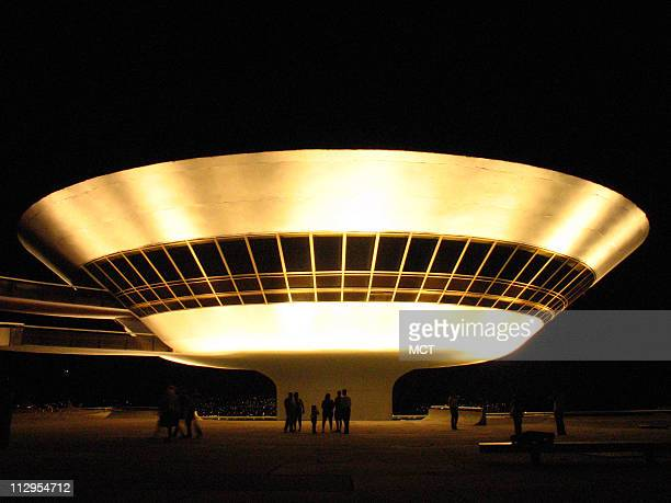 The distinctive Museum of Contemporary Art illuminates the skyline October 15 in Niteroi Brazil Legendary Brazilian architect Oscar Niemeyer designed...