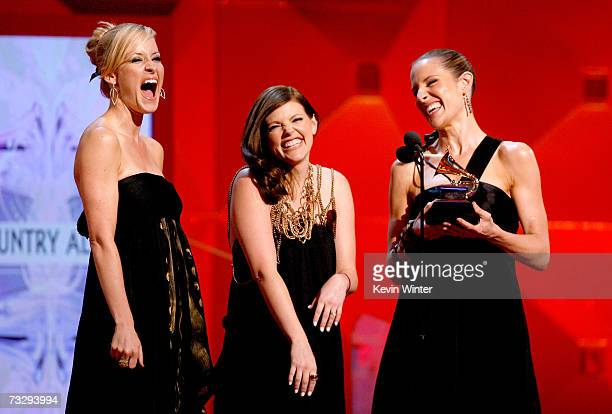 The Dixie Chicks Martie Maguire Natalie Maines and Emily Robinson accept their award for 'Best Country Album' for Taking the Long Way Home onstage at...